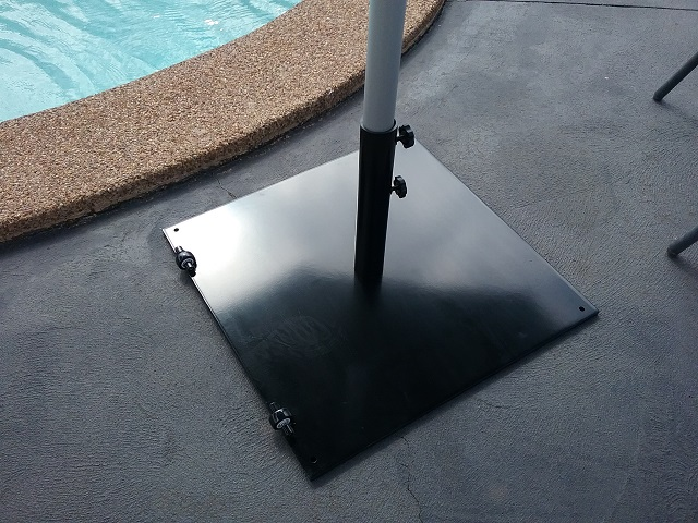 A 4.0m Octagonal SU2, in Black, with a 36kg steel base and a 3.5m Octagonal SU7, also in Black, with a surface plate installed at a property in Greystanes, NSW.