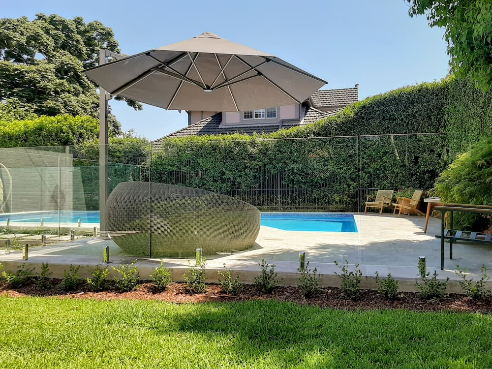 Outdoor pool umbrella in Wahroonga. This is the first of the New 3.5m Serenity model we have installed. Very popular Charcoal Tweed canopy. Very happy customer.